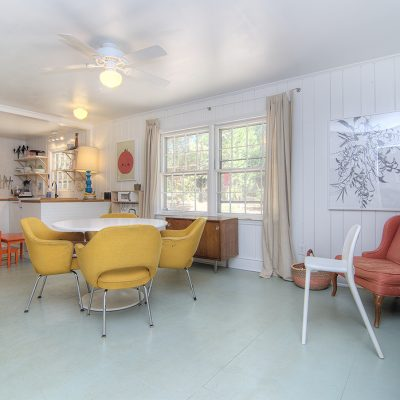 cottage kitchen opens to large dining area