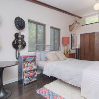 1311 Greylyn Dr mid-century modern charlotte home bedroom with vaulted ceilings and built-ins