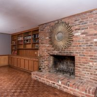 Den Study with built in cabinets and masonry fireplace