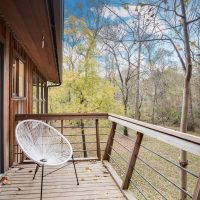 Back Porch with cantilevered copper railing